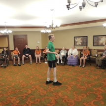 Good Shepherd Lutheran Church-Shoreview Senior Living-boy playing charades