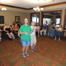 Good Shepherd Lutheran Church-Shoreview Senior Living-women teaming up on charades