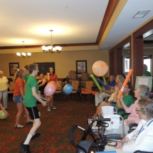 Good Shepherd Lutheran Church-Shoreview Senior Living-children playing balloon ball with seniors