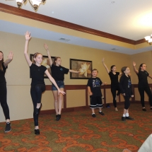 Children's Performing Arts-Shoreview Senior LIving-children extending their arms in dance