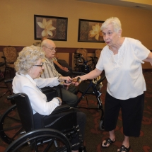 Coral Bells-Shoreview Senior Living-shaking hands