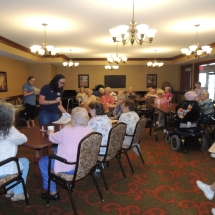 July Silverwood Nature Center Visit-Shoreview Senior Living-listening to Silverwood Nature Center