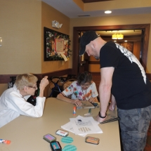 July Silverwood Nature Center Visit-Shoreview Senior Living-volunteer checking out their work