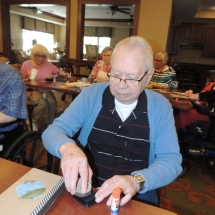 July Silverwood Nature Center Visit-Shoreview Senior Living-man working hard on his journal