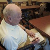 July Silverwood Nature Center Visit-Shoreview Senior Living-man hard at work drawing