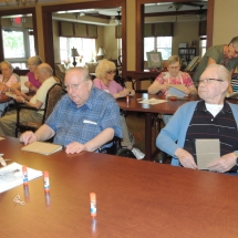 July Silverwood Nature Center Visit-Shoreview Senior Living-senior men learning about nature