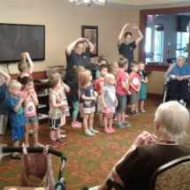 Kinder-care-Shoreview Senior Living-the children entertaining the seniors