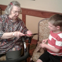 Kinder-care-Shoreview Senior Living-children learning from the tenants