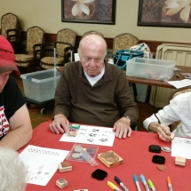Crafts with Jill-Shoreview Senior Living-hard at work on his pins and magnets