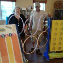 Labor Day Fair Games-Shoreview Senior Living-posing next to all of the games
