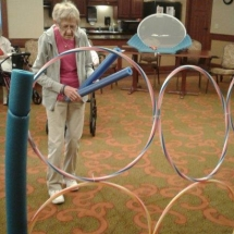Labor Day Fair Games-Shoreview Senior Living -tenant concentrating on the game