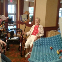 Labor Day Fair Games-Shoreview Senior Living-winding up for the ball and hoop toss game