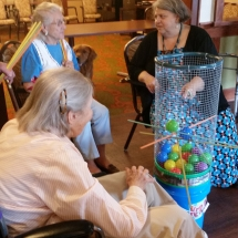 Labor Day Fair Games-Shoreview Senior Living-ladies gathered around a game