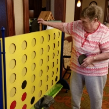 Labor Day Fair Games-Shoreview Senior Living-getting closer to her four in a row