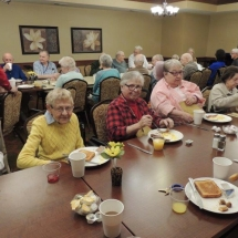 September Made to Order Breakfast-Shoreview Senior Living-Table enjoying their pancackes