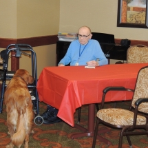 Tea and Trivia with Leo-Shoreview Senior Living-Leo keeping one of the tenants company