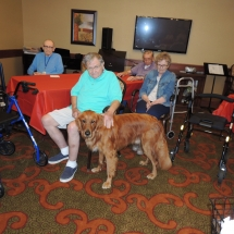 Tea and Trivia with Leo-Shoreview Senior Living-senior man giving Leo some lovin