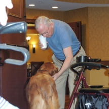 Tea and Trivia with Leo-Shoreview Senior Living-giving Leo some scratches