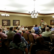 Crime Prevention and Mexico Oraphanage-Shoreview Senior Living-Tenants listening to Deputy Mike