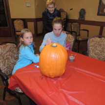 Pumpkin Painting-Shoreview Senior Living-little girl helper