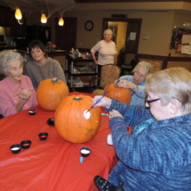 Pumpkin Painting-Shoreview Senior Living-painting eyes