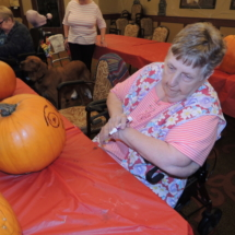 Pumpkin Painting-Shoreview Senior Living-taking a break from painting
