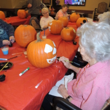 Pumpkin Painting-Shoreview Senior Living-white pumpkin face