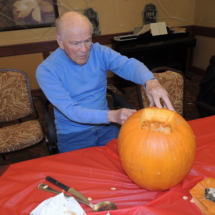 Pumpkin Painting-Shoreview Senior Living-carving out the pumpkin