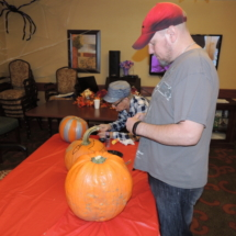 Pumpkin Painting-Shoreview Senior Living-looking over the pumpkins
