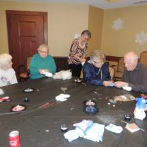 Sock Snowmen Craft at Shoreview Senior Living