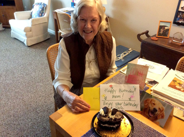Our friend, Carol, enjoying birthday surprises from her lovely family!
